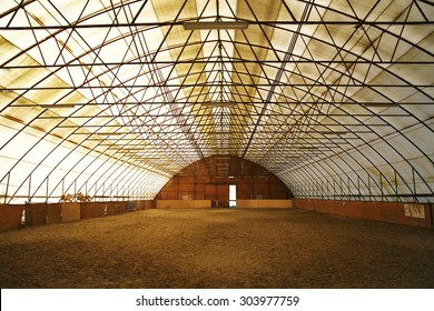 Indoor riding arena covering sand for trainings