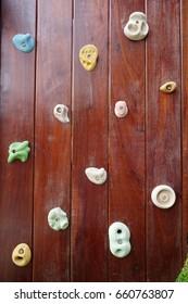 Indoor rock climbing wall texture. Kids climbing playground.