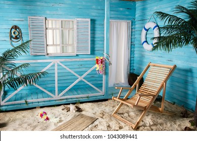 Indoor room with deck chair sand beach like blue house wooden bungalow with palms