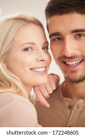 Indoor shot of a cute young Caucasian couple smiling.