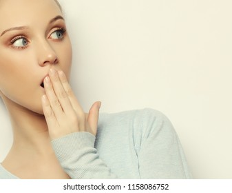 Indoor shot of stupefied shocked blonde woman keeps mouth widely opened, looks at camera, wears casual clothes, isolated over white background. Attractive female model indoor