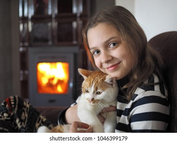 indoor shot young girl with cat