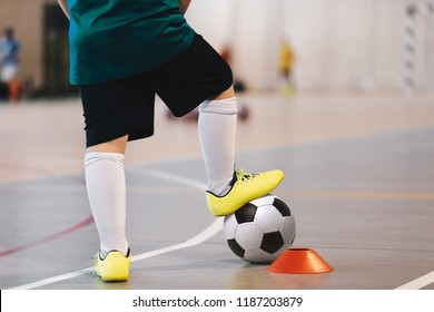 Indoor soccer player training with balls. Indoor soccer sports hall. Football futsal player, ball, futsal floor. Sports background. Futsal league. Indoor football players with classic soccer ball.