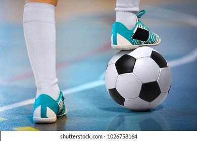 Indoor soccer sports hall. Football futsal player, ball, futsal floor. Sports background. Youth futsal league. Indoor football players with classic soccer ball.