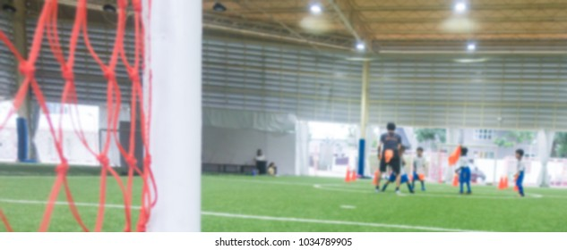 Indoor soccer training field blur abstract for background