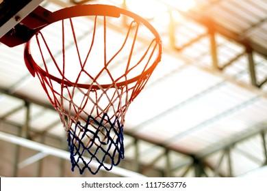 indoor sport basketball hoop in gym under metal sheet roof