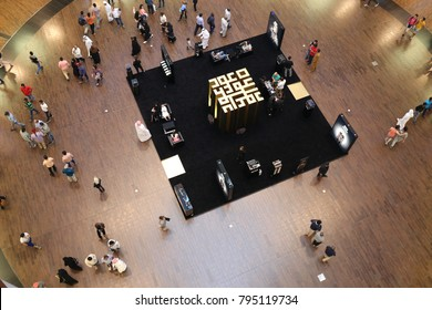 Indoor view from above of dubai mall with people walking in front of the lighted shops. Several floors with curves for shopping. Modern life. This urban  picture has been taken on 18th Juy 2015.