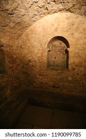 Indoor view of the cloakroom of the medieval mikveh of montpellier city, France. September, 16, 2018. Wall, floor, ceiling and bench made of stone. Historical place with an Interior underground room.