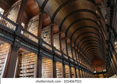 Indoor view of the famous Library of Trinity College Dublin in Ireland. Long room with wooden vaults and columns. Perspective view with all the ancient books. Picture taken on 7th august 2016.
