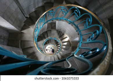 Indoor view of sete lighthouse in France. Pattern of steps with a blue metallic handrail. Picture taken on 29th march 2018. Stone wall with vertical window. Architectural image with a spiral shape.
