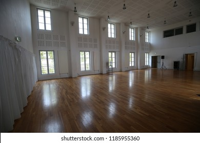 Indoor view of Yano studio, a dance hall located in the national choreography center of Montpellier city, called Agora in France. September, 16, 2018. Wooden parquet and white high walls with windows.
