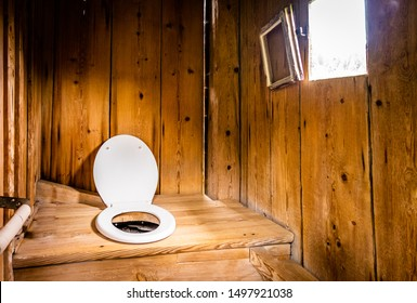 indoors an old wooden outhouse