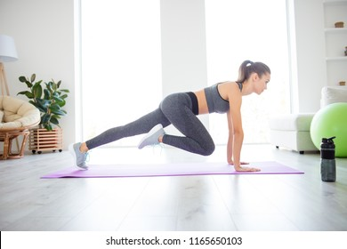 Indoors runner window day light dream improvement wellbeing vitality concept. Full length size photo portrait of sporty sportive sexy sexual lady doing exercise for hips on purple mat