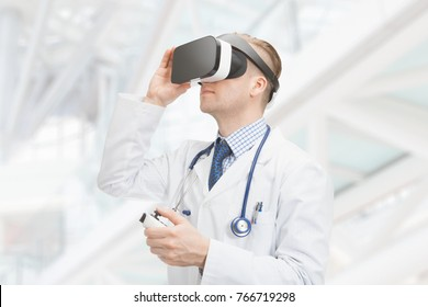 Indoors shot of doctor using virtual reality glasses