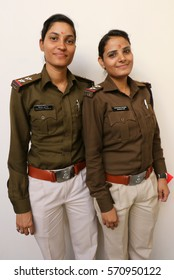 Indore, India - January 30, 2017: Two lady police officers posing with a sweet smile.