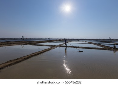 Indramayu, Indonesia 29 August 2015 - Unidentified man working at the salt fields