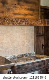 Induction cooktop in decorative wooden kitchen