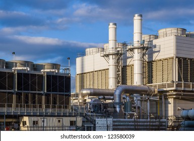 Industiral cooling plant in late afternoon with blue sky