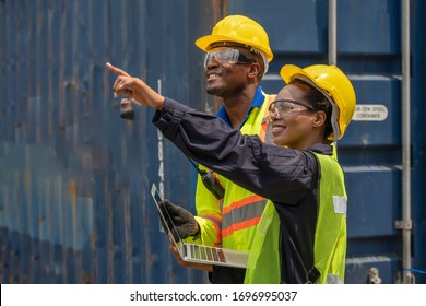 industrail background of african american containers yard and cargo inspector team working at containers loading area