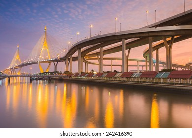 Industrail Ring Bridge across the river at twilight time with water reflexion, Bangkok Thailand