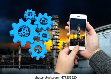 Industrial 4.0 Cyber Physical Systems concept, Gears and blue industry4.0 icons and Robot and Engineerer human holding hand with handshake , oil refinery industry,3D illustration
