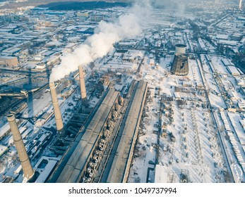Industrial aerial drone view to power plant in winter