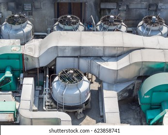 Industrial air conditioner condensers (outside unit) on the roof of a building on a hot summer day in Manila, Philippines