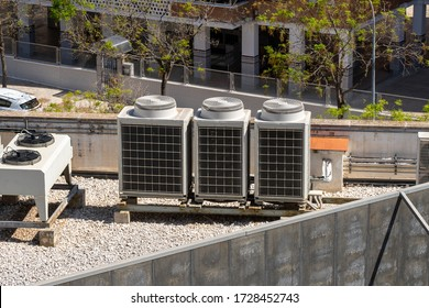 Industrial air conditioner units on a rooftop of a building. HVAC machines.
