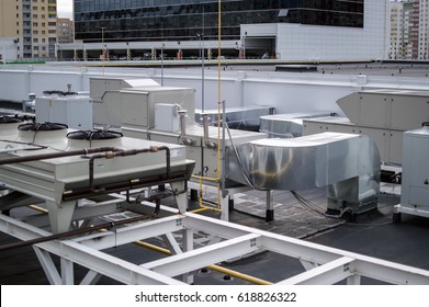Industrial air conditioning, ventilation and refrigent systems on the roof of the shopping mall center