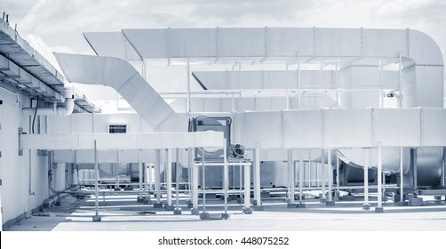 Industrial Air Ventilation system on top roof of office building.