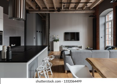 Industrial apartment with kitchen island and open living room