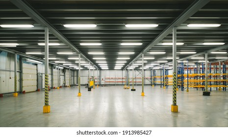 Industrial architecture. Modern interior of huge empty storehouse. New distribution warehouse with rack stack. Metal construction.
