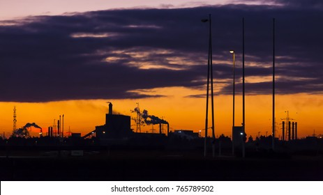 Industrial area of incense chimneys with rising day.