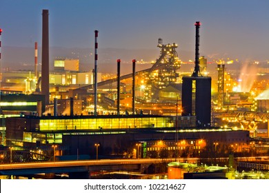 an industrial area of ??the metal industry in the evening. lights of the production.