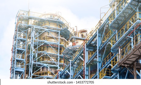 Industrial area of the refinery. Oil refining equipment and pipelines of the refinery. Toned