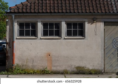 in a industrial area in south germany you see older walls and buildings and patterns good for abstract use as background