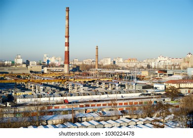 Industrial area, winter, day, sun, garages, roads, plant.