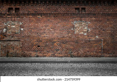 Industrial background, empty grunge urban street with warehouse brick wall