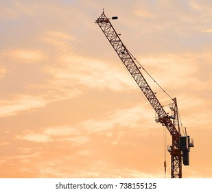Industrial Background, Large Construction Site Including Several Crane with Golden Sky and Sunrise in The Morning.