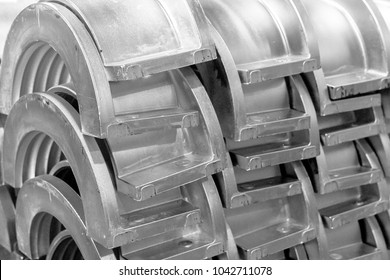 Industrial background from part aluminium casting flanges, oil or gas industry
