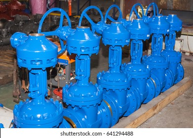 Industrial background from part of valves for power, oil or gas industry. Casting carbon steel boides. Forging stainless still parts.