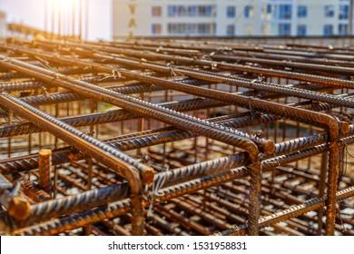 Industrial background. Rebar texture. Rusty rebar for concrete pouring. Steel reinforcement bars. Construction rebar steel work reinforcement. Closeup of Steel rebars.