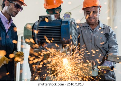 Industrial background. Welder in a factory