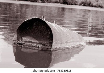 Industrial barrel thrown into the lake for garbage and make a big pollution. Water pollution