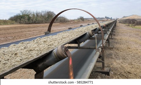 Industrial belt conveyor. Moving Raw Materials.