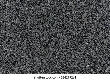 Industrial black vinyl carpet Coil Pattern Car Floor Mat texture. Close up anti slippery surface vinyl dust background image.