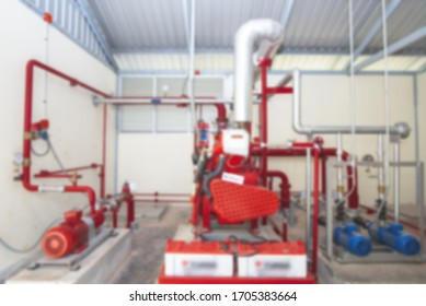 Industrial blurred,Water pressure control room,Several water pumps with large electric motors,Modern industrial boiler room.Water treatment pipes and pressure gauges installed for pressure control.