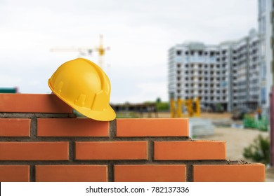 Industrial bricklayer and yellow hemlet
