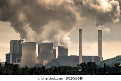 Industrial brown coal power plant chimney smokestack emission.