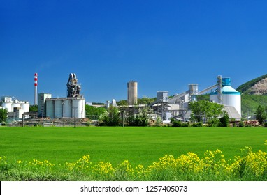 Industrial buildings on factory site in agricultural landscape